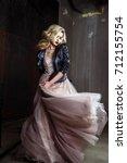 beautiful blonde young bride... | Shutterstock . vector #712155754