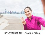 woman taking a selfie after... | Shutterstock . vector #712167019
