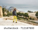 girl tourist on the top of... | Shutterstock . vector #712187800