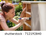 woman is painting an old...   Shutterstock . vector #712192840