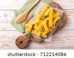 polenta fries with sea salt ... | Shutterstock . vector #712214086