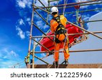 workers up high with safety...   Shutterstock . vector #712225960