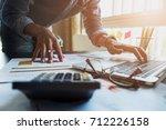 accountants work analyzing... | Shutterstock . vector #712226158