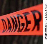 danger red tape warning in... | Shutterstock . vector #712235710