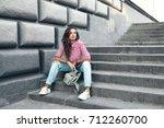 fashion model wearing ripped... | Shutterstock . vector #712260700