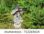 hunter is on a forest clearing...   Shutterstock . vector #712265614