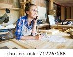 cheerful young carpenter... | Shutterstock . vector #712267588