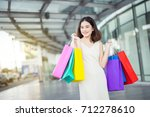 asian woman in shopping. happy... | Shutterstock . vector #712278610