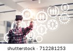 young man with virtual reality...   Shutterstock . vector #712281253