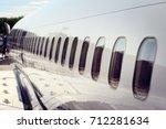 windows on airplane... | Shutterstock . vector #712281634