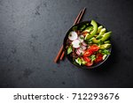 red quinoa buddha bowl with... | Shutterstock . vector #712293676