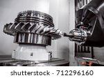 Small photo of Metalworking CNC milling machine. Cutting metal modern processing technology. Small depth of field. Warning - authentic shooting in challenging conditions. A little bit grain and maybe blurred.
