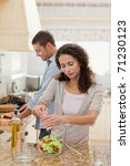 handsome man cooking with his...   Shutterstock . vector #71230123