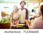 couple of buyers standing by... | Shutterstock . vector #712306600