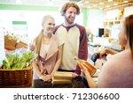 couple of buyers standing by... | Shutterstock . vector #712306600