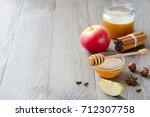 bowl of honey  honey stick ... | Shutterstock . vector #712307758