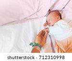 newborn baby first days of life ... | Shutterstock . vector #712310998