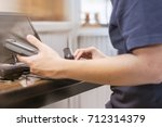 technician using a computer fix ... | Shutterstock . vector #712314379