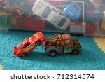 Small photo of Tow Matter pulling Lighting McQueen with a crane after accident from the Mattel toy car collection of Disney's Cars movie on September 2017 in Poznan, Poland