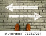 person's feet in suede shoes is ... | Shutterstock . vector #712317214