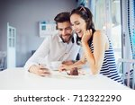 young loving couple checking... | Shutterstock . vector #712322290