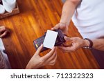 top view of female hand holding ... | Shutterstock . vector #712322323