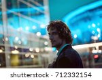 young stylish guy on the... | Shutterstock . vector #712332154