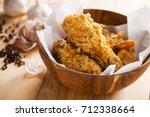 fried chicken in wooden bowl... | Shutterstock . vector #712338664