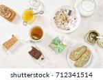breakfast table with muesli... | Shutterstock . vector #712341514