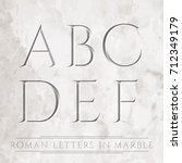 ancient roman letters chiseled... | Shutterstock .eps vector #712349179