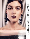 fashion studio photo of...   Shutterstock . vector #712352980