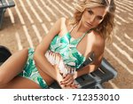 fashion outdoor photo of... | Shutterstock . vector #712353010