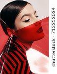 fashion studio photo of...   Shutterstock . vector #712353034