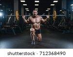 handsome young muscular... | Shutterstock . vector #712368490