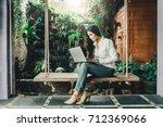 hipster asian woman relaxing...   Shutterstock . vector #712369066