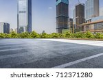 empty road with modern business ...   Shutterstock . vector #712371280