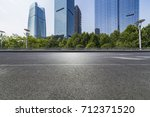 empty road with modern business ... | Shutterstock . vector #712371520