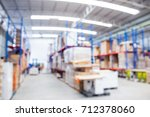blurred image of warehouse that ... | Shutterstock . vector #712378060
