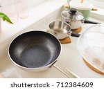 pan and pot in white kitchen... | Shutterstock . vector #712384609