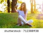 beautiful young woman taking a... | Shutterstock . vector #712388938