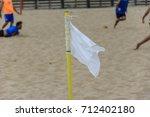 white flag signaling a corner... | Shutterstock . vector #712402180