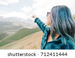 explorer young woman pointing... | Shutterstock . vector #712411444