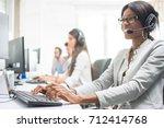 friendly female helpline... | Shutterstock . vector #712414768