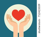 charity day. hands with a heart.... | Shutterstock .eps vector #712423339