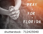 hand of woman praying  pray for ... | Shutterstock . vector #712425040