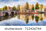 amsterdam canal houses  vibrant ... | Shutterstock . vector #712426744