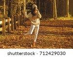 young woman wearing warm... | Shutterstock . vector #712429030