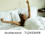 happy woman waking up after... | Shutterstock . vector #712433698
