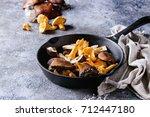 heap of fresh forest porcini...   Shutterstock . vector #712447180