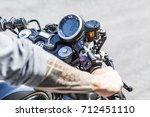 cool looking tattoos on arms of ... | Shutterstock . vector #712451110